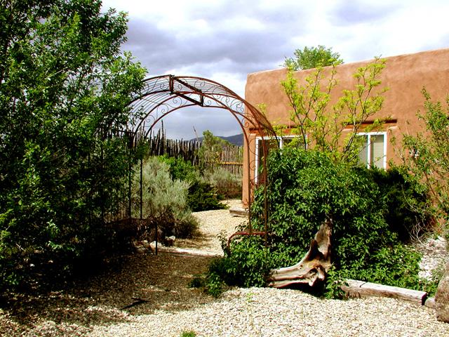 The yard and entry once inside the coyote privacy fence (SEE ADDITIONAL PHOTOS / GUEST COMMENTS ON NEXT PAGE - Link below) - Casita Romantica Cabin - Taos - rentals
