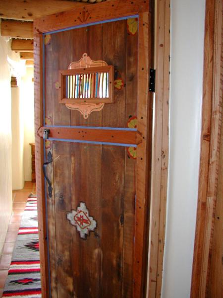 Hand carved interior door - Montana Luz Hacienda - Taos - rentals