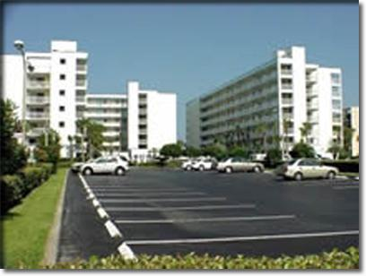 Main Complex from Parking Area - Sandcastles Direct Oceanside Condo - Cocoa Beach - rentals
