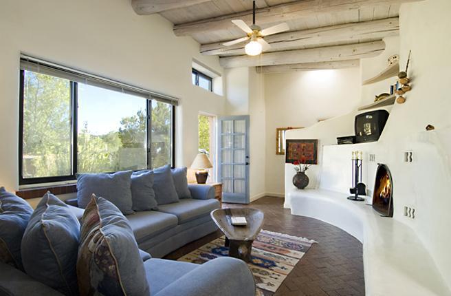 Cerro Gordo Casita living room with fireplace - Cerro Gordo Casita - 30 Day Minimum - Santa Fe - rentals