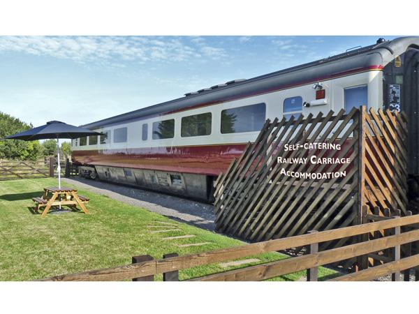 CONVERTED RAILWAY CARRIAGE, family friendly, character holiday cottage, with a garden in Hawsker, Ref 3877 - Image 1 - Whitby - rentals