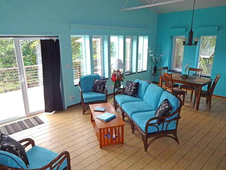 Living / Dining Room - window wall to garden; SAT TV & Entertainment Center - Snorkel Sun Rejuvenate- Kapoho Kaiyo Ocean Retreat - Pahoa - rentals