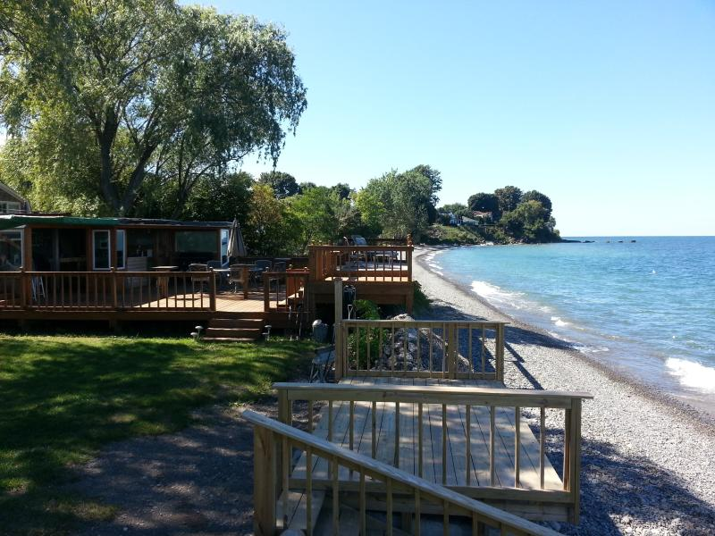 The Party Deck and enclosed Tiki Bar - Beachfront Vacation Cottages - Olcott - rentals
