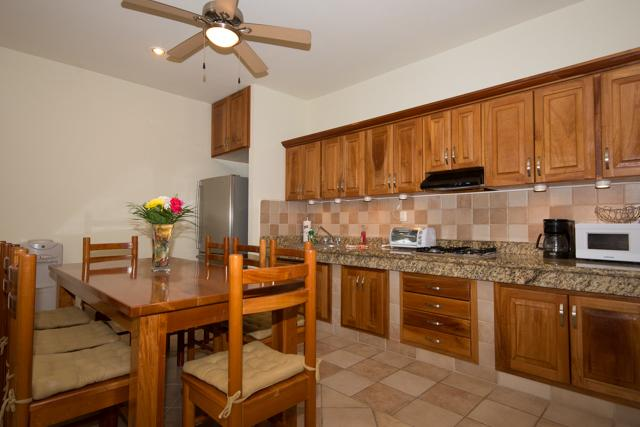 Fully equiped kitchen with granite countertop and dining table which seats up to eight people. - PLAYAINN 2 - a hidden gem steps from Mamitas! - Playa del Carmen - rentals