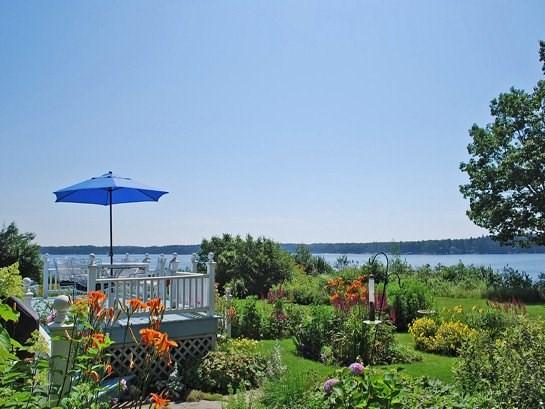 The beautiful gardens and water frontage at Bayberry Cottage - BAYBERRY COTTAGE - Town of Cushing - Cushing - rentals
