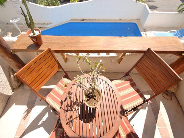 Quaint and private patio overlooking the pool. - CASA DEL SOL B2 sunny, bright condo with pool view - Playa del Carmen - rentals