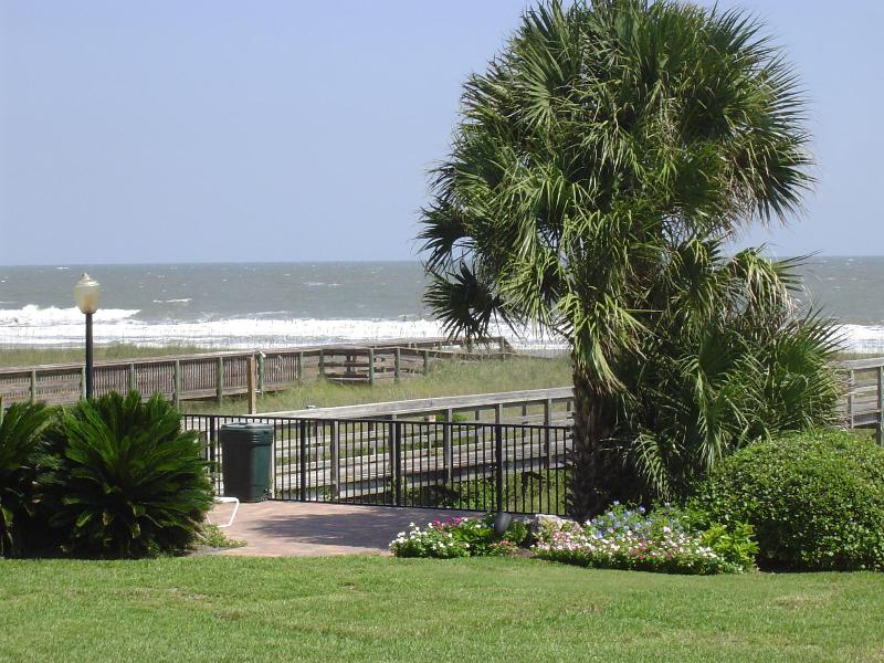 Atlantis has a brick patio overlooking the ocean with lounge chairs and tables - Atlantis on Amelia Oceanfront Condo-just remodeled - Fernandina Beach - rentals
