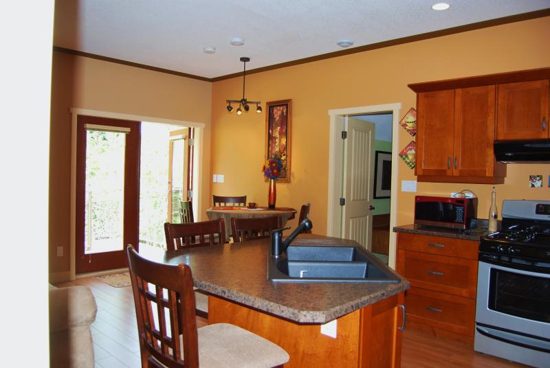 Dining area, french doors to upper deck - Brand New Oceanview Carriage House vacation rental - Courtenay - rentals