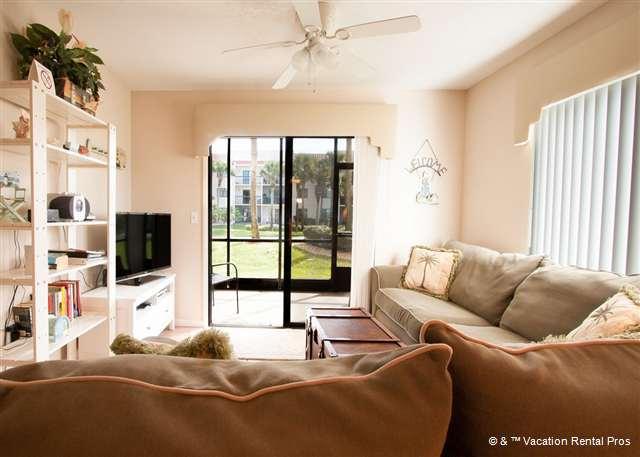Sit back and enjoy the ocean breezes in our living room - Ocean Village N14, Ground Floor, heated pool, HDTV, Blue Ray - Saint Augustine - rentals