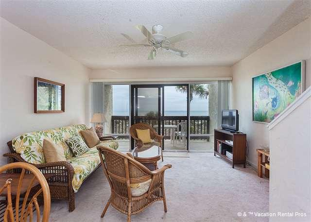 Our bright and sunny living room is the perfect place to relax! - Island House A 207 Beach Front Rental, HDTV, Pool, St Augustine - Saint Augustine - rentals
