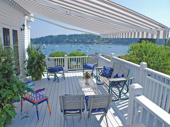 Porch with awning overlooking Tenants Harbor - THE SAIL LOFT - Town of St George - Tenants Harbor - Saint George - rentals