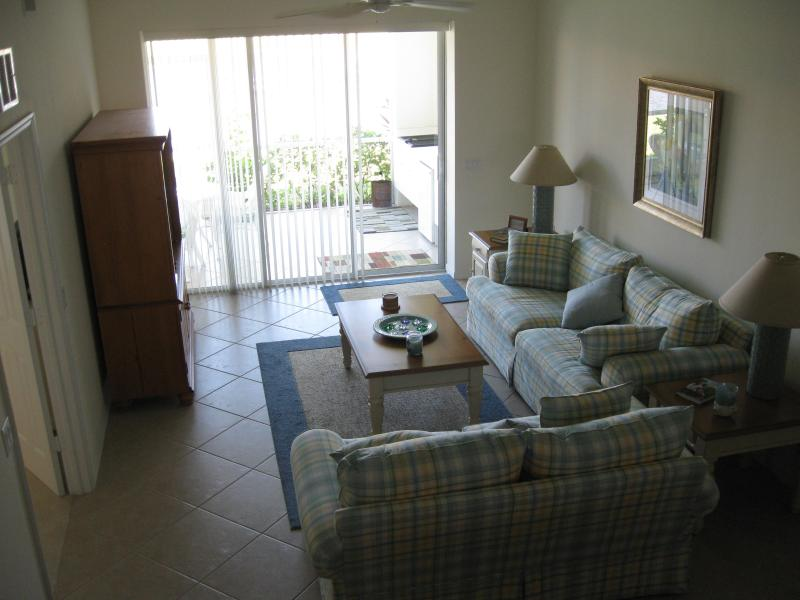 Luxuriously comfortable living room with flat screen LCD and extra deep couches - Beautiful Falling Waters Condo - Naples - rentals