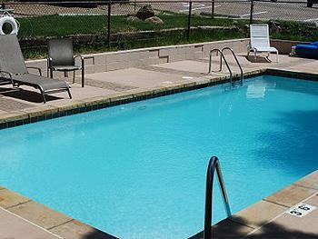 The Outdoor Heated Swimming Pool is Open Seasonally and Just Outside the Condo - Scenic & Secluded Estes Park CO Cond 3Bdrm/2Bath - Estes Park - rentals