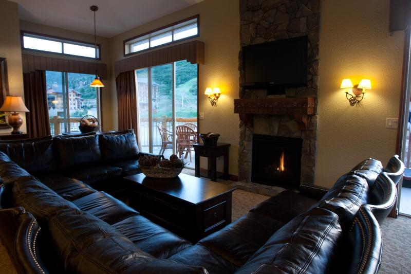 Main Room and fireplace - 5 Star Ski/Out, 4BD VIEW Luxury Condo w/ hot tub! - Park City - rentals