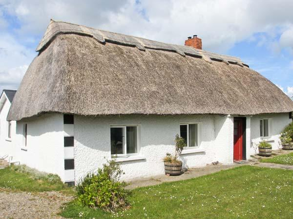 STRAWHALL, family friendly, character holiday cottage, with a garden in Gorey, County Wexford, Ref 4335 - Image 1 - Gorey - rentals