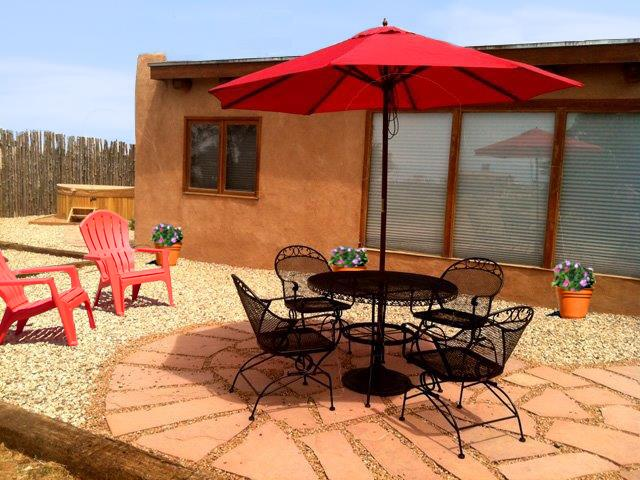 Shaded patio dining table showing hot tub in background - Beinn Bhreagh Cabin / Casita - Taos - rentals