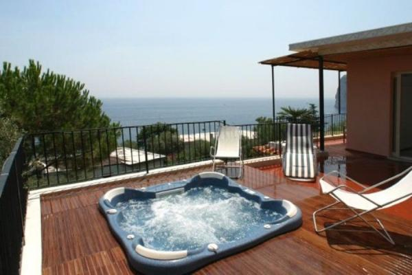 Luly, Bright & Romantic with Panoramic Jacuzzi - Image 1 - Marina del Cantone - rentals