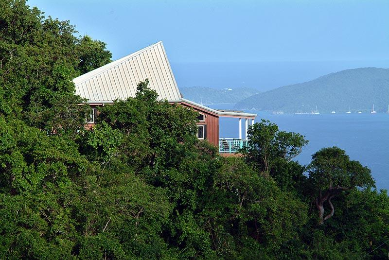 Debolina (Sailing into the Wind) is nestled in the hillside of Ajax Peak. - DeBolina - Coral Bay - rentals