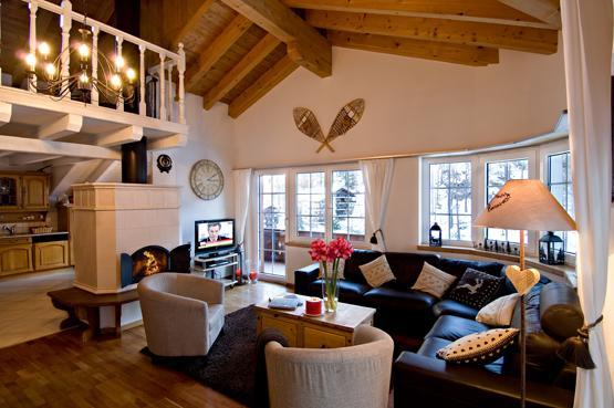 High ceilinged living room with wood fire - Chalet Carmen - Matterhorn Express base station - Zermatt - rentals
