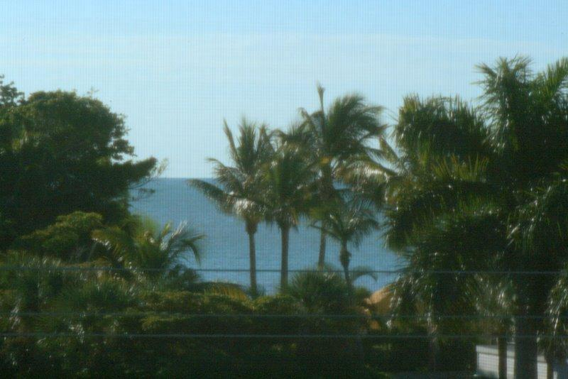 """""""peek-a-view"""" of Gulf from our lanai - Steps to beach, great rates, stylish interior--Holiday weeks still available - Sanibel Island - rentals"""