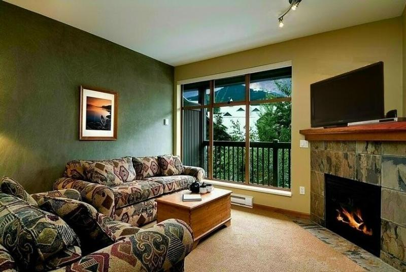Relax in front of the fire. We provide cable TV and a selection of Games, DVDs & Books - Northstar Luxury Condo - Whistler - rentals