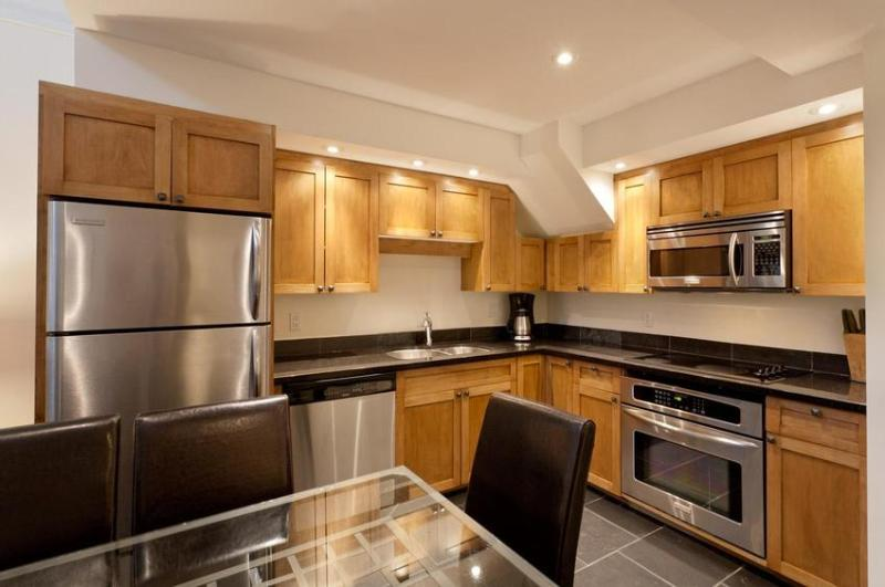 Enjoy cooking in this new kitchen fully equipped with stainless steel appliances, heated slate floors, granite counters, convection oven and all the cooking items required to prepare full meals. - Whistler Ideal Accommodations - ski in ski out - 1 Bedroom and Loft - Whistler - rentals