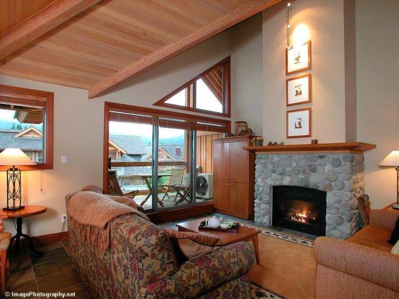 Cozy, upstairs living area with direct view of BOTH mountains, large flat screen TV, gas fireplace and private deck with BBQ - Whistler Ideal Accommodations: Montebello Chalet - 4 bedrooms - Whistler - rentals