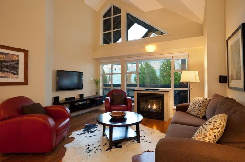 Enjoy a sense of quality in the spacious and bright living room featuring Vaulted/Cathedral ceilings soaring up to 20', Solid Bamboo Flooring, Italian leather club chairs and a 42inch LCD TV with 5 Speaker Stereo. - Glacier Lodge Ski In/Out One Bedroom & Loft - Whistler - rentals
