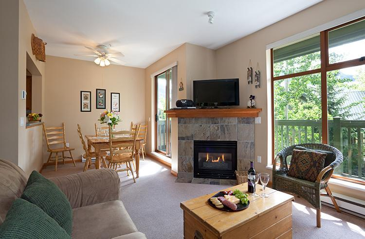 Comfortable living room and dining room with views of Whistler & Blackcomb peaks. - In Village Sleeps 7, Walk to Lifts, Shops, Dining - Whistler - rentals