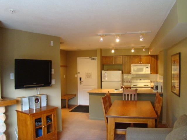 aerial view of fully equipped gourmet kitchen and dining table with complimentary coffee and tea - Family Retreat - Whistler - rentals