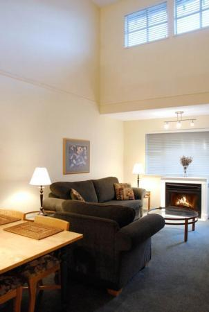 Open concept living and dining area with with cathedral ceilings and new large flat screen LCD TV! - Whistler Ideal Accommodations: Ski In Ski Out - 1 Bedroom Plus Loft - Whistler - rentals