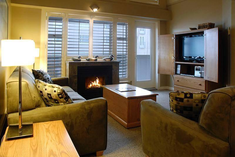 Open concept living and dining area with entrance to private deck and new large flat screen LCD TV! - Whistler Ideal Accommodations: Glacier Lodge 2 bedroom Ski in ski out - Whistler - rentals