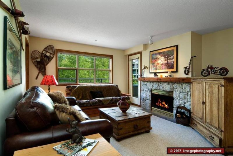 Living Room: Beautiful fireplace that is perfect to snuggle up to after a long day on the slopes. - WHISTLER CHALLET - Whistler - rentals