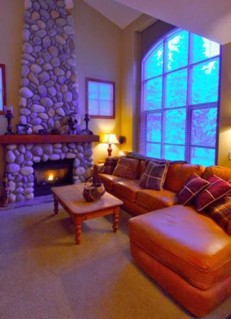 cosy living room with entertainment center and floor to ceiling stone fireplace - Gerhard Schumacher - Sun Peaks - rentals