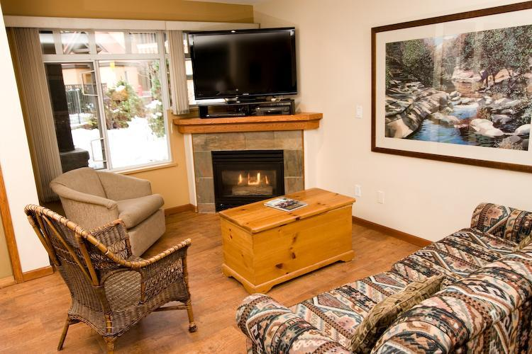 Relax in front of the fireplace and large flat screen TV. Please view the photo gallery for more pictures of our unit. - Sunpath Comfort - Whistler - rentals
