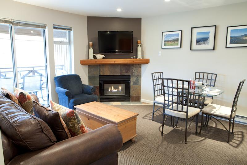 Spacious living room with new sofa bed, flat screen TV, ipod stereo, dining table with seating for four, and cozy gas fireplace (please click on photo gallery at left for additional photos) - Quiet Mountain View Suite steps to everything Whistler - Whistler - rentals