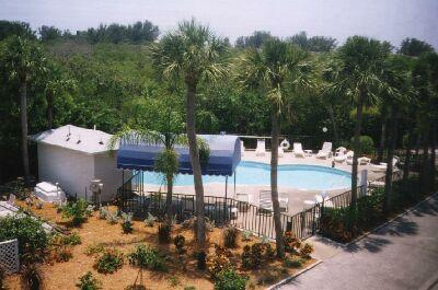 Our view of the Sandy Pointe pool - Blue Bayou - Holmes Beach - rentals