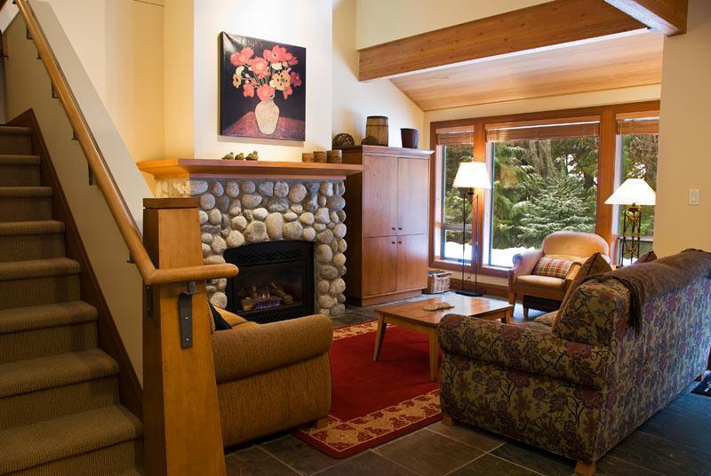 Warm open living room with 15ft vaulted ceiling surrounded by woods and River Rock gas fireplace. Complete entertainment system,TV, DVD,VCR,CD stereo and Queen sofa sleeper - LisaJo and Joseph Chard - Whistler - rentals