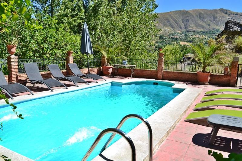View across pool to valley beyond - Villa 10 min to Alhambra and 30 min to ski resort. - Province of Granada - rentals