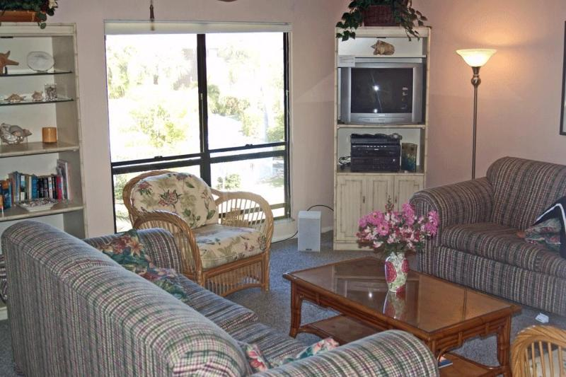 The living room is a spacious, relaxing space to hang at the end of the day - Secluded Sanibel condo with beach, pool - Sanibel Island - rentals