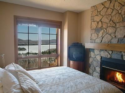 Bedroom with fireplace and amazing views - Luxury Condo - sleeps 5 - Directly on ski slopes - Mont Tremblant - rentals