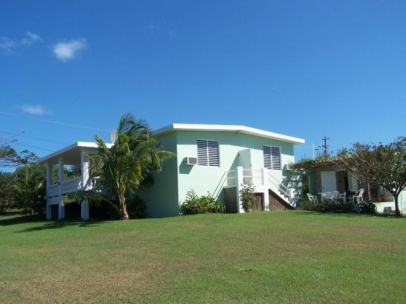 Spacious private grounds with a lovely ocean view  Back view shows casita off patio - Tranquility By The Sea / We are near the beach!! - Isla de Vieques - rentals