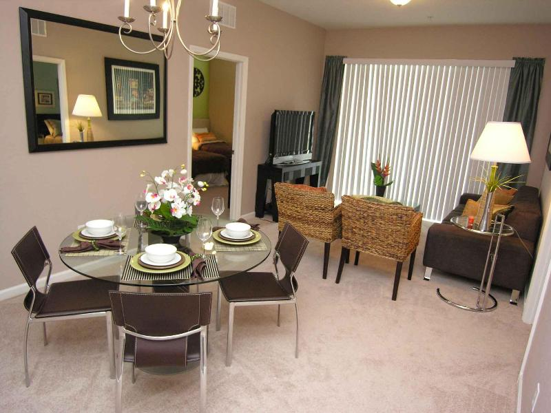 Living room and Dining area - Luxury Condo @ Hotel prices -Isles of Cay Commons - Orlando - rentals