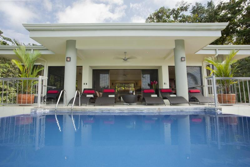 Pool with loung chairs offers jungle and ocean views - Modern Luxury, Wildlife, Ocean View, Private Pool - Manuel Antonio National Park - rentals