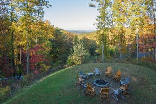 "Gather around the fire pit to roast marsh mellows - ""Cherokee Lodge"" Luxury Log Cabin, Firepit, Pool Access, Game Room, Mtn Views - Gatlinburg - rentals"