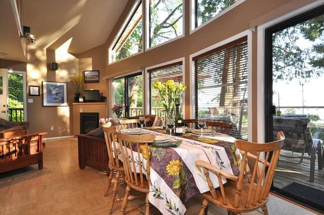Open concept, living & dining area. - KONRAD COTTAGES Beachfront Chalet -- save 10-33%! - Halfmoon Bay - rentals