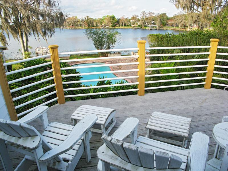 Beautiful balcony view overlooking pool, patio, & lake. - Lakefront Guest Aptmt. Winter Springs, Oviedo, FL - Winter Springs - rentals