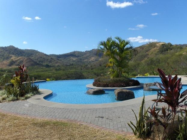 Infinity pool area - upper level - perfect for sunsets! - Beautiful Condo - 2 minutes from Pacific Ocean! - Playa Ocotal - rentals