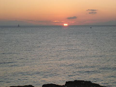 Sunset while having a drink in balcony - Seven Mile Beach, Grand Cayman Vacation Rental - 7 Mile Beach Front Condo right on Ocean, Pvt Beach - Seven Mile Beach - rentals
