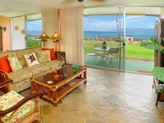 Looking out to the ocean from the living room. - $129 OCEANFRONT Maui condo - 40 ft from water! - Lahaina - rentals